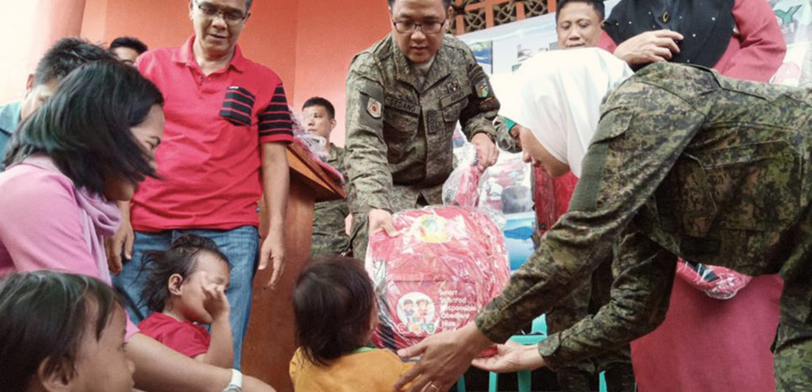 12th CMO battalion conducts medical mission, distributes slippers
