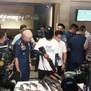 PNP welcomes surrender of 20 NPA rebels in Laguna
