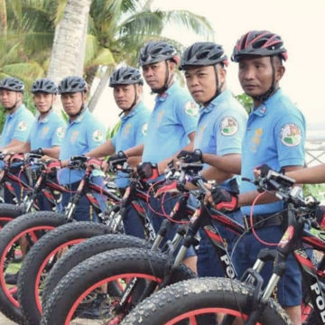 Tourist police in PH surfing capital receive patrol bikes