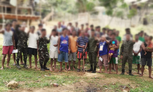 28 NPA terrorists, supporters in Tandag give up arms
